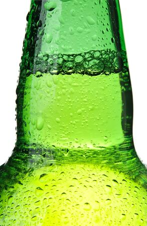 Beer bottle abstract closeup, green wet bottle with water droplets