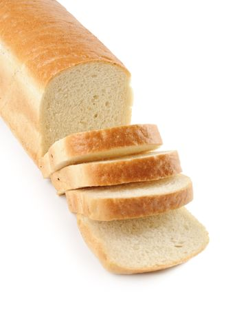 A loaf of white bread, sliced, isolated on white.