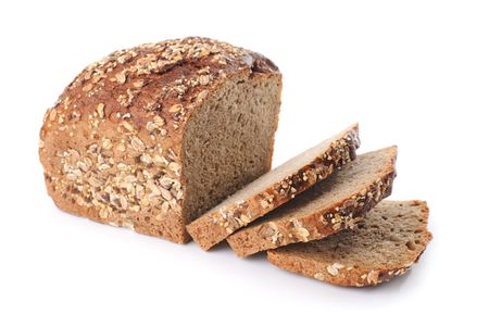 carbohydrate: Sliced homemade brown bread with cereals. Isolated over white  Stock Photo