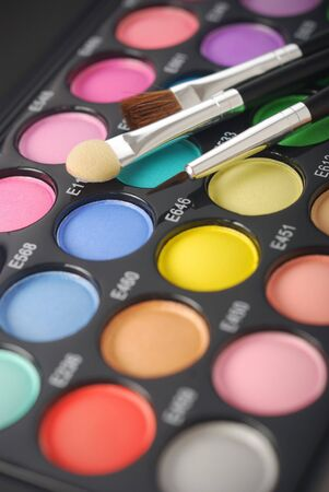 Makeup palette and brushes photo