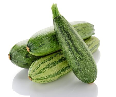 Two fresh zucchini isolated photo