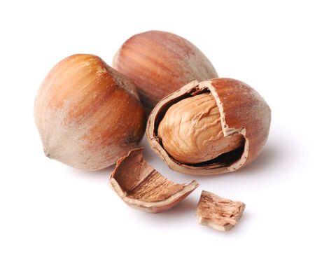 Three hazelnuts. Isolated on white background photo