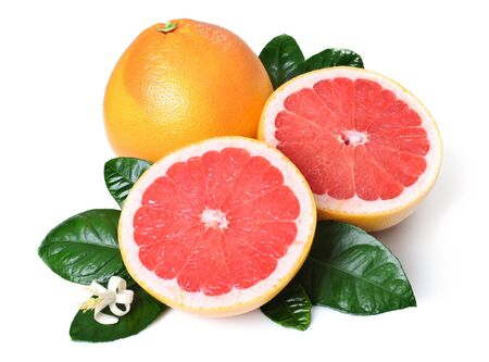Whole grapefruit and halves with leaves and flower. Isolated over white background. Archivio Fotografico