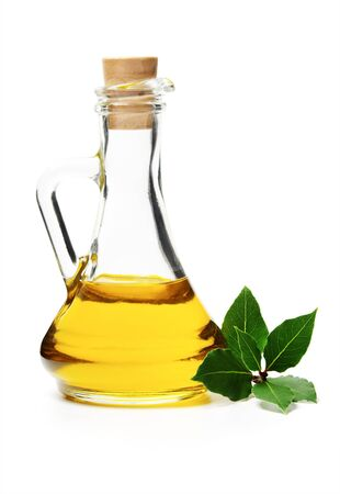 Glass bottle with oil and laurel branch Stock Photo
