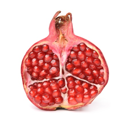 Half of pomegranate. Isolated over white.