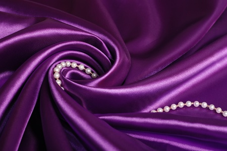 pearl necklace on purple satin Stock Photo
