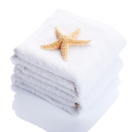Stack of white towels. Isolated on white background.