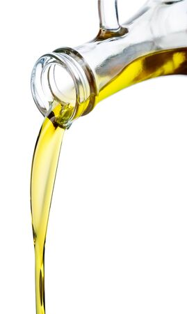 Olive oil pouring out of a bottle. Isolated on white.