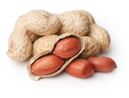 monkey nuts: Monkey nuts in a pile isolated on a white  Stock Photo