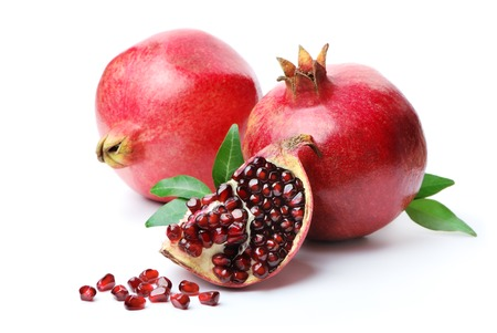 Pomegranates on a white . Isolated.