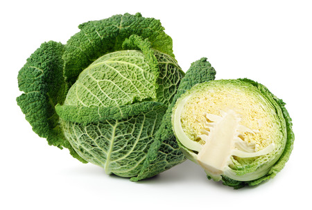 Two savoy cabbages isolated over white