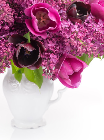 Tulips and Lilac bouquet in white vintage vase  Standard-Bild