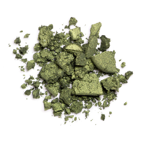 Crushed green eye shadow isolated on white background Standard-Bild