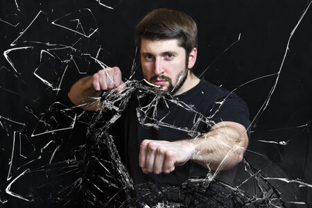 resolute: The resolute man a fist breaks glass