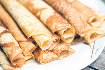 Roasted rolled pancakes on a plate. With toning . Shallow DOF