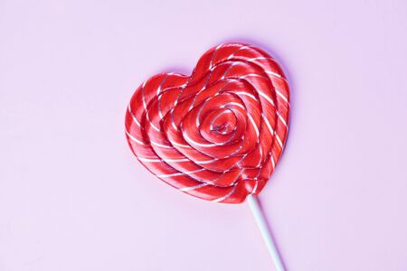 sucker: One candy heart shape on pink background Stock Photo