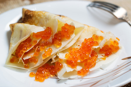 shallow dof: Homemade pancakes with red caviar on a plate. Shallow DOF Stock Photo