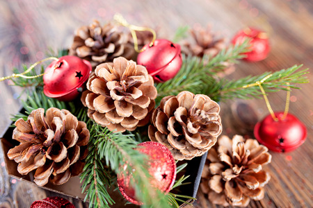 Christmas composition from branches of spruce and tree cones on