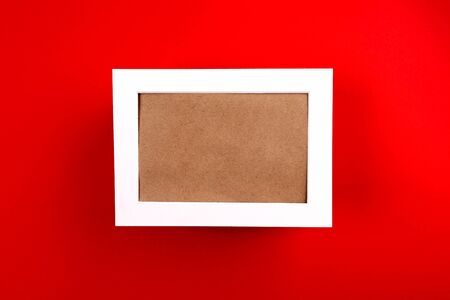Christmas background. White frame on red paper background.
