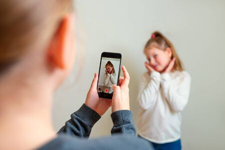 Teens record video on camera for blog. Stock Photo