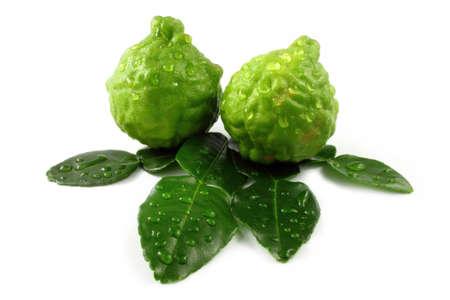A beautiful fresh bergamot and bergamot leaves on white background  photo