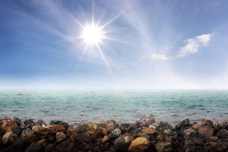 a beautiful sparkle sun above a sea photo
