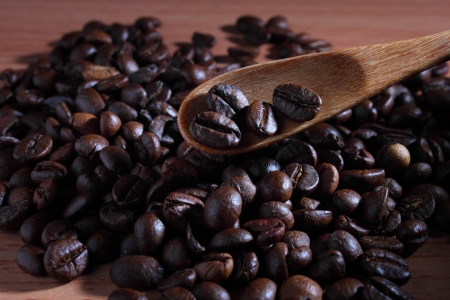 the coffee beans in a wooden spoon photo