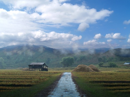 field hut mountain and sky in countryside photo