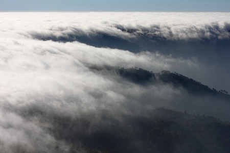 mist sea of fog clouds and the mountain photo