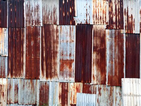 Galvanized sheet rusted into the wall.