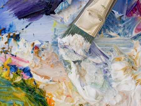 Artists oil paints and brush multi coloured closeup photo