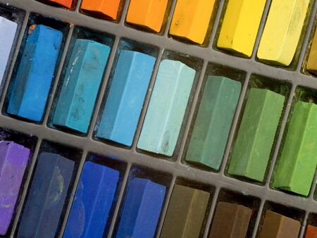 Multi coloured artists pastel crayons close up photo