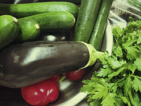courgettes: Vegetable ingredients. Colourful courgettes, aubergines and tomatoes.