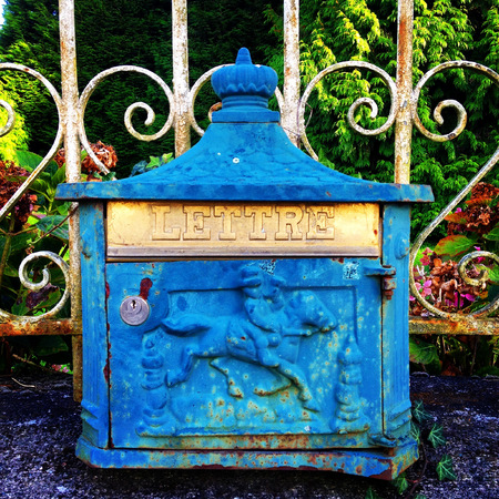 Art deco letterbox on railings outside a village house in Normandy, France. photo