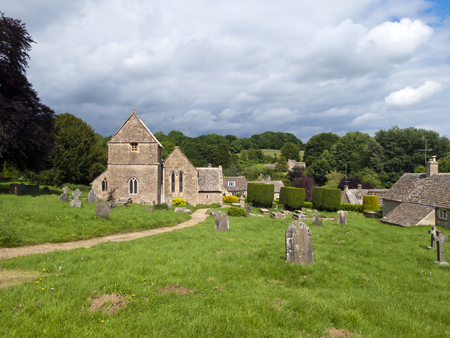 cotswold: Picturesque old church in Duntisbourne Abbotts, an idyllic Cotswold village, Gloucestershire, UK Stock Photo