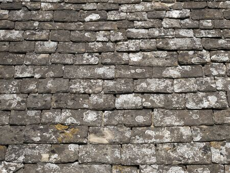 cotswold: Lichen covered Cotswold stone roof tiles full frame background
