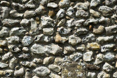 dorset: Decorative flint built wall on Cranbourne village church, Dorset, UK Stock Photo