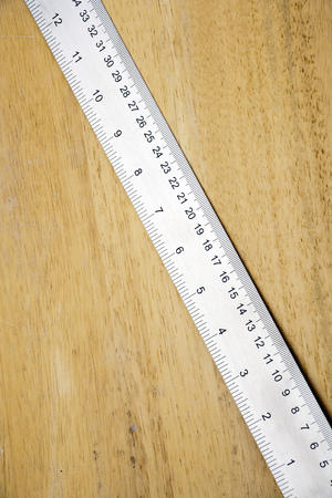 centimetres: A shiny new steel rule on wood with copy space Stock Photo