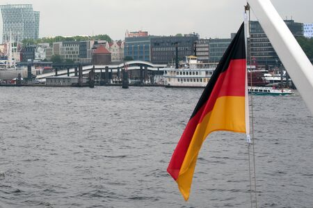 Port of Hamburg 2012 - Germany flag in front of the piers