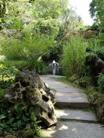 Japanese Garden - artificial fountain in unspoilt surroundings photo
