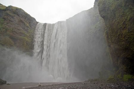 The South Islands, the scenic waterfall Skogafoss which here falls down in a width of 25 meters to 60 meters deep on the River Edge Skoga photo