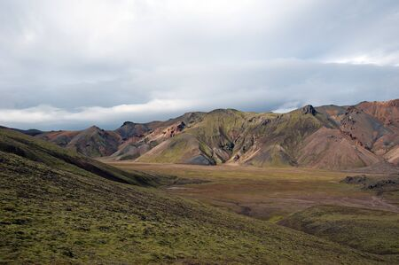 The southwest of Iceland, volcanic valley against a backdrop in Landmannalaugar
