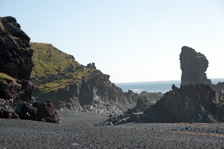 The west of Iceland, at the western end of the peninsula Sneifellsnes, lava field on the black beach of Djupalonssandur