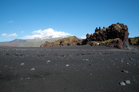 The west of Iceland, at the western end of the peninsula Sneifellsnes, overlooking the volcano Sneifellsjökull, from the black beach of Djupalonssandur  Stock Photo
