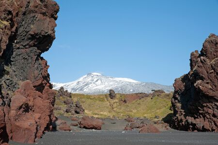 mineralized: The west of Iceland, at the western end of the peninsula Sneifellsnes, overlooking the volcano Sneifellsj�kull, from the black beach of Djupalonssandur