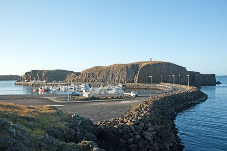 The West Island, overlooking the harbor of Stykkisholmur the basalt island S�gandisey with the lighthouse in the north of Snaefellsnes Stock Photo