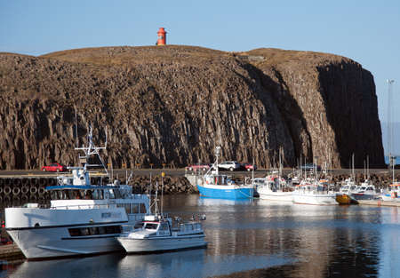 The West Island, overlooking the harbor of Stykkisholmur the basalt island S�gandisey with the lighthouse in the north of Snaefellsnes Editorial