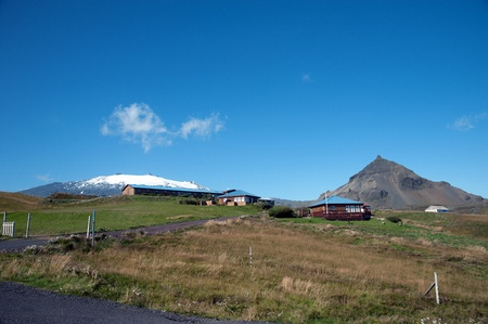 The Northwest Islands, overlooking the volcano and glacier Sneifellsjoekull and its neighboring mountain Stapafell  Eagle Rock  at the western end of the Sneifellsnes