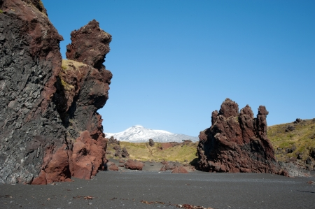 The west of Iceland, at the western end of the peninsula Snaefellsnes, overlooking the volcano Snaefellsjökull, from the black beach of Djupalonssandur  Stock Photo