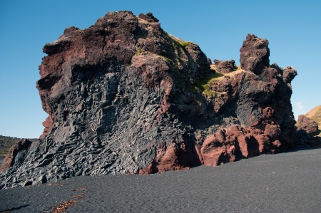 The west of Iceland, at the western end of the peninsula Sneifellsnes, overlooking the mineral rich lava, from the black beach of Djupalonssandur
